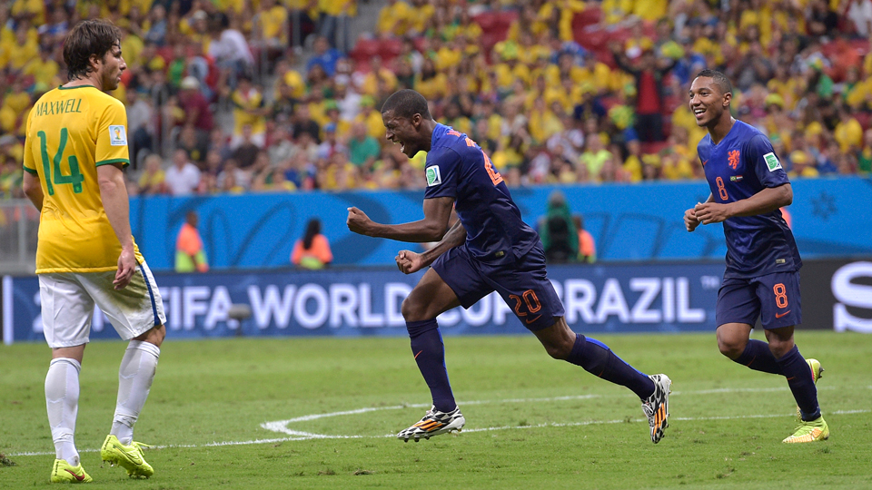 Netherlands' Georginio Wijnaldum, center, celebrates his stoppage-time goal that capped the Dutch's 3-0 win over Brazil in the World Cup third-place match.