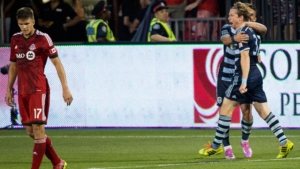 Sporting Kansas City's Jacob Peterson, right, celebrates his game-winning goal against Toronto FC on Saturday.