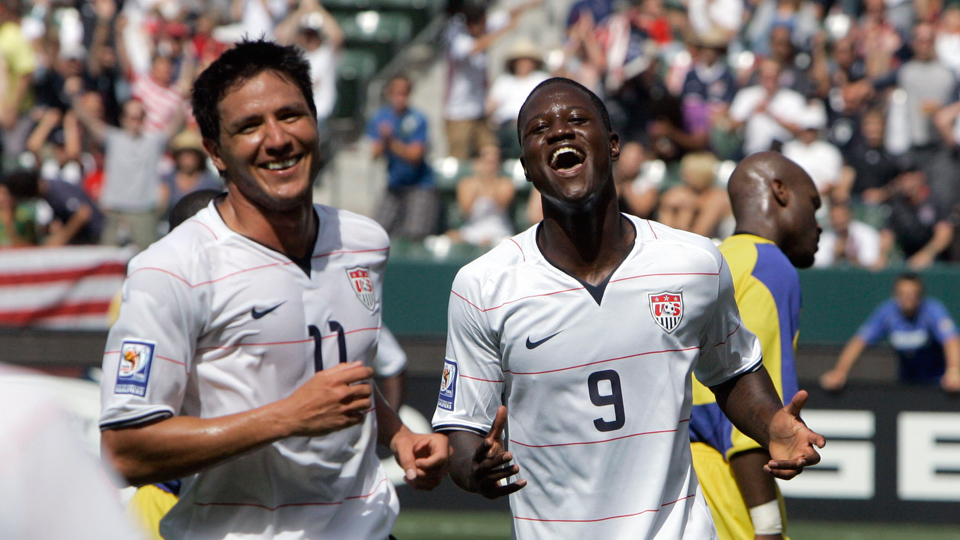 Former USA teammates Brian Ching, left, and Eddie Johnson during a 2008 World Cup qualifying match.
