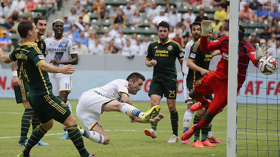 The Galaxy's Robbie Keane (center) scored twice to lead LA to a 3-1 home win over the Portland Timbers.