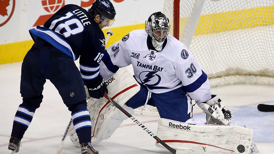 After a breakout season in 2013–14, goalie Ben Bishop (30) signed a two-year extension with the Lightning for $5.95 million per year.