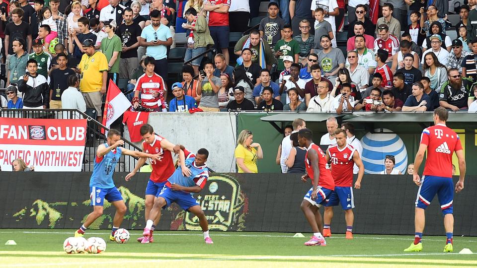 Fans in Portland watch as Bayern Munich –including U.S. international Julian Green, third from left –train ahead of Wednesday's MLS All-Star Game.