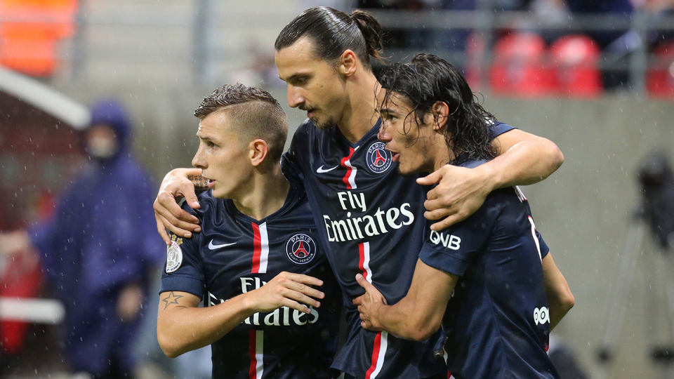 Zlatan Ibrahimovic, center, celebrates one of his two goals for PSG against Reims with Lucas Digne, left, and Edinson Cavani.