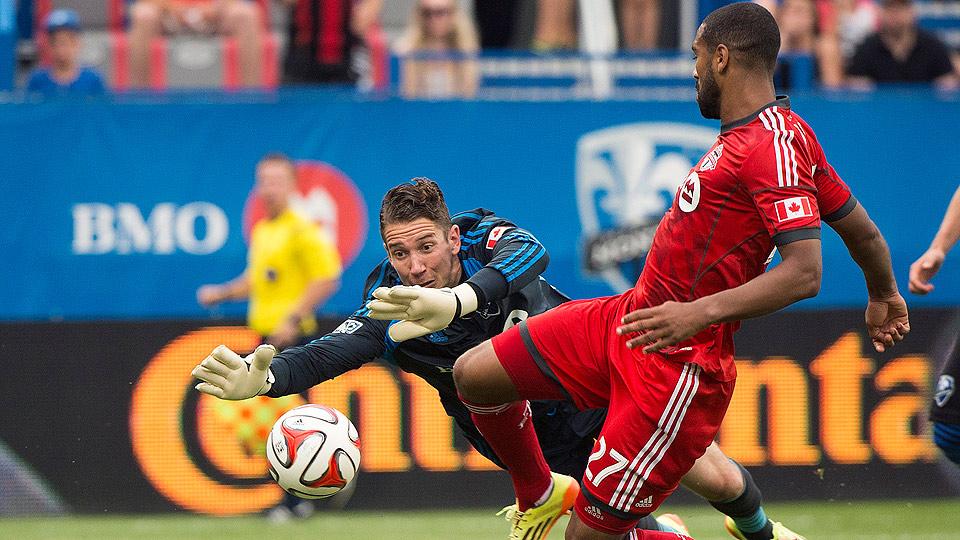 Toronto FC's Luke Moore, shown scoring on Montreal Impact goalkeeper Troy Perkins on Aug. 2, netted the decisive goal against the Columbus Crew.