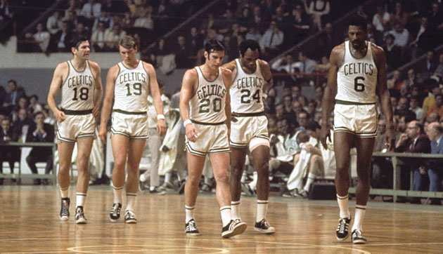 Russell (right) led the Celtics as both player and coach when they won titles in 1968 and '69, his last two seasons in uniform.