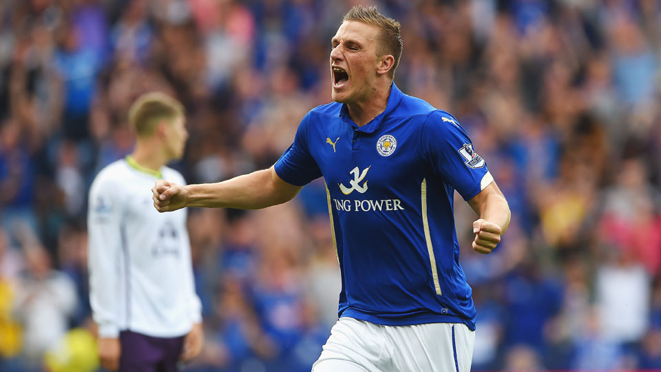 Chris Wood's late equalizer gave Leicester City a 2-2 draw with Everton in its first match of the new Premier League season.