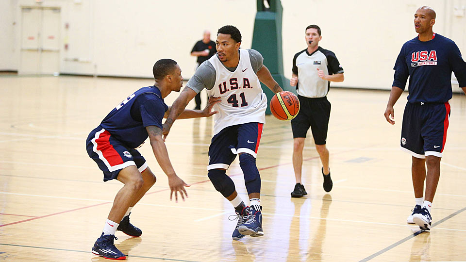 Team USA's Damian Lillard (left) attempts to guard Derrick Rose, who will be making a Chicago homecoming Wednesday night vs. Brazil.