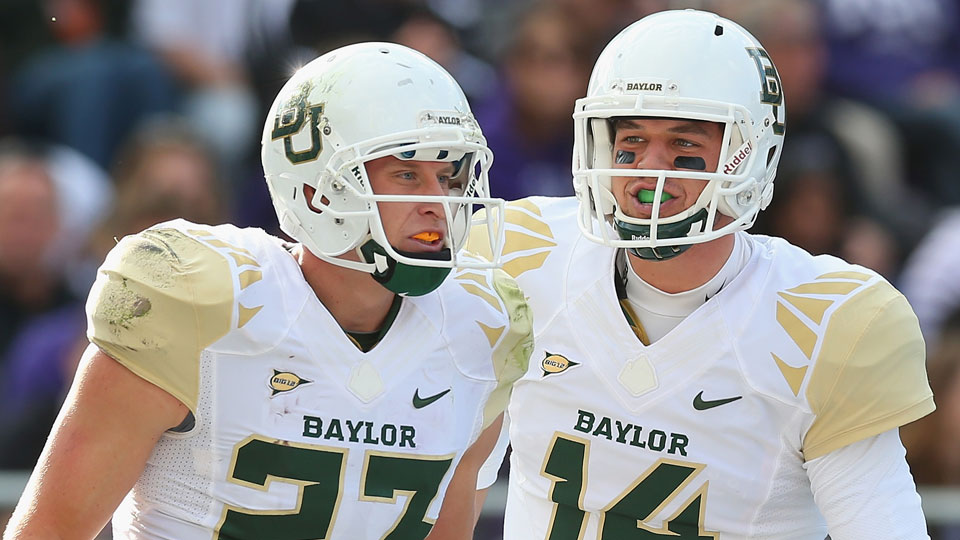 Clay Fuller (lefty) and Bryce Petty (right) of Baylor football
