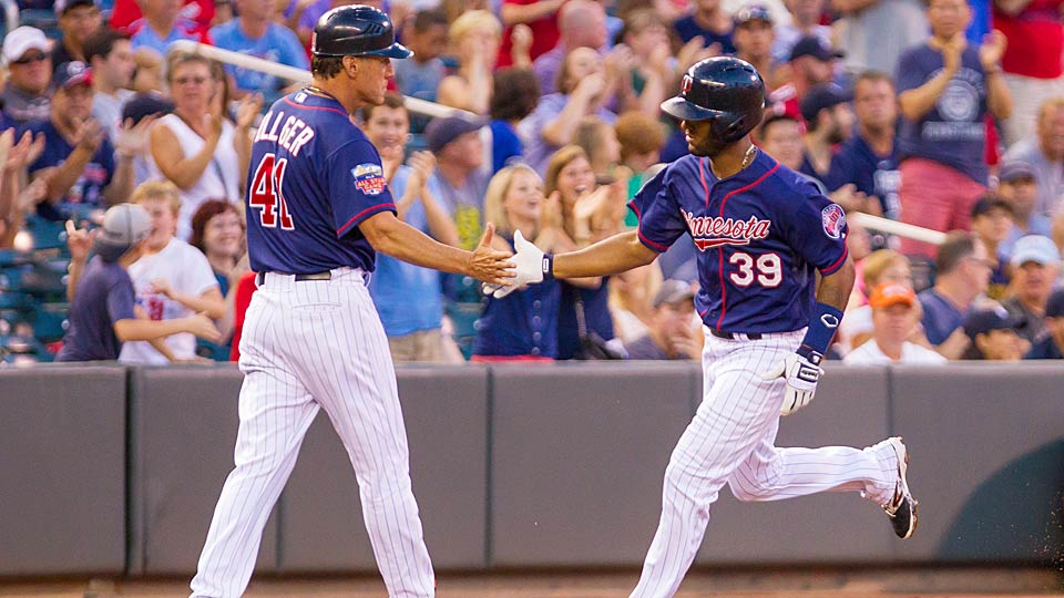 Twins center fielder Danny Santana high fives third base coach Scott Ullger after homering in the second inning vs. the Detroit Tigers en route to a Minnesota blowout.