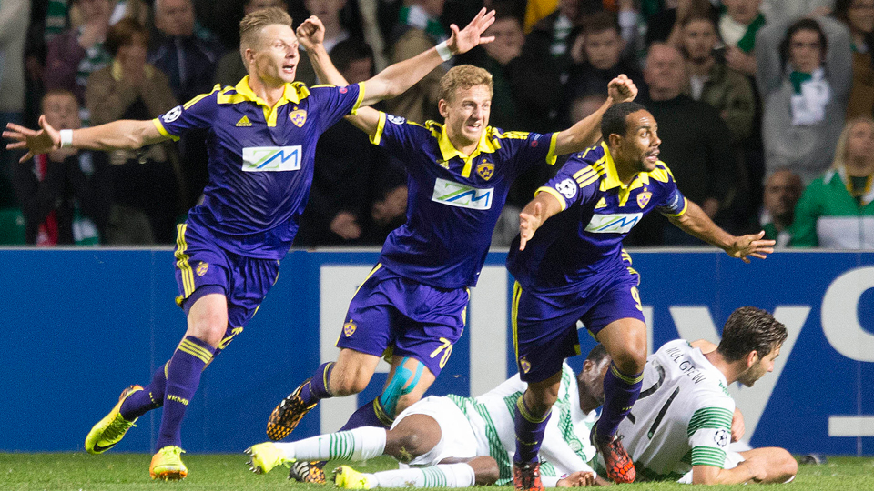 Maribor players celebrate during their Champions League play-in victory over Celtic, which sealed their place in the group stage.