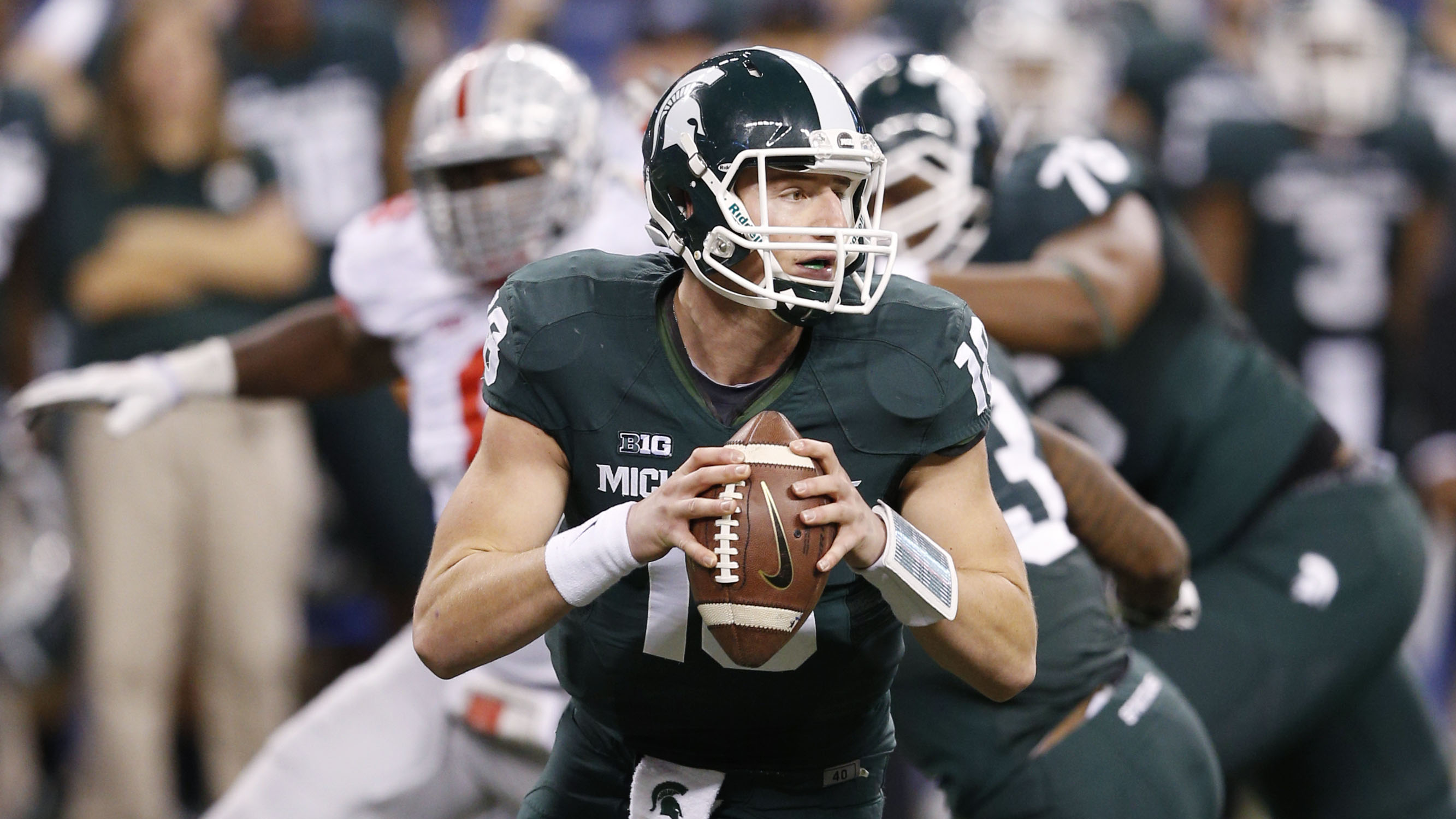 Michigan State quarterback Connor Cook returns to lead the Spartans offense.