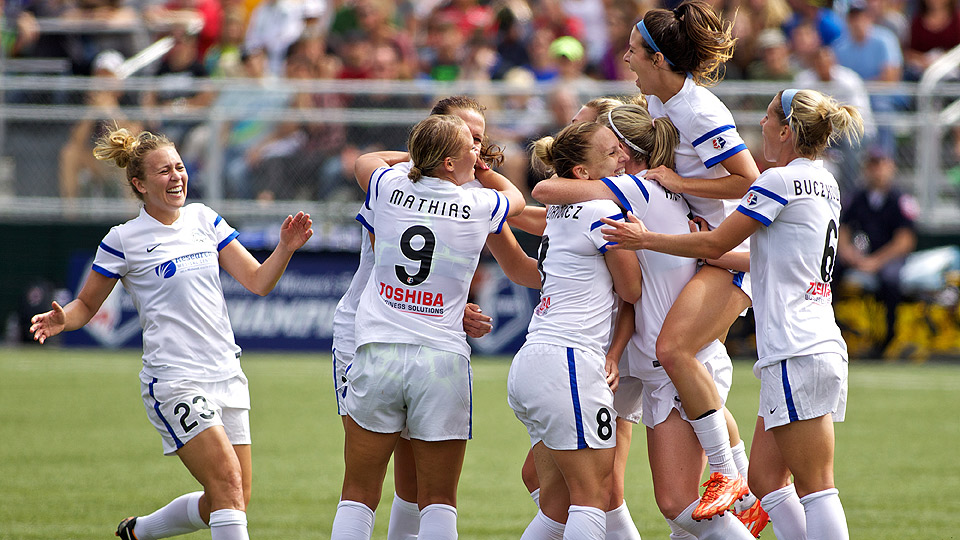 Amy Rodriguez (8) celebrates with her teammates after scoring the decisive goal to knock off the Seattle Reign and win the NWSL championship.