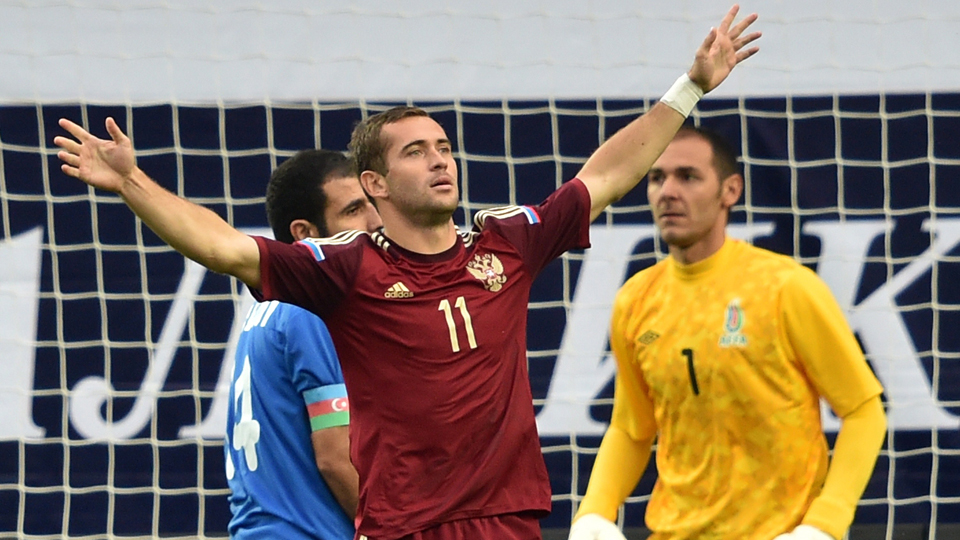 Alexander Kerzhakov celebrates one of his two goals for Russia in a 4-0 win over Azerbaijan on Wednesday.