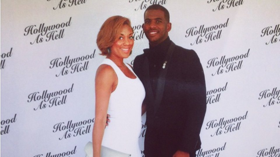 The Hollywood as Hell saying behind this photo of Chris Paul and guest was the backdrop at Dwyane Wade's wedding.