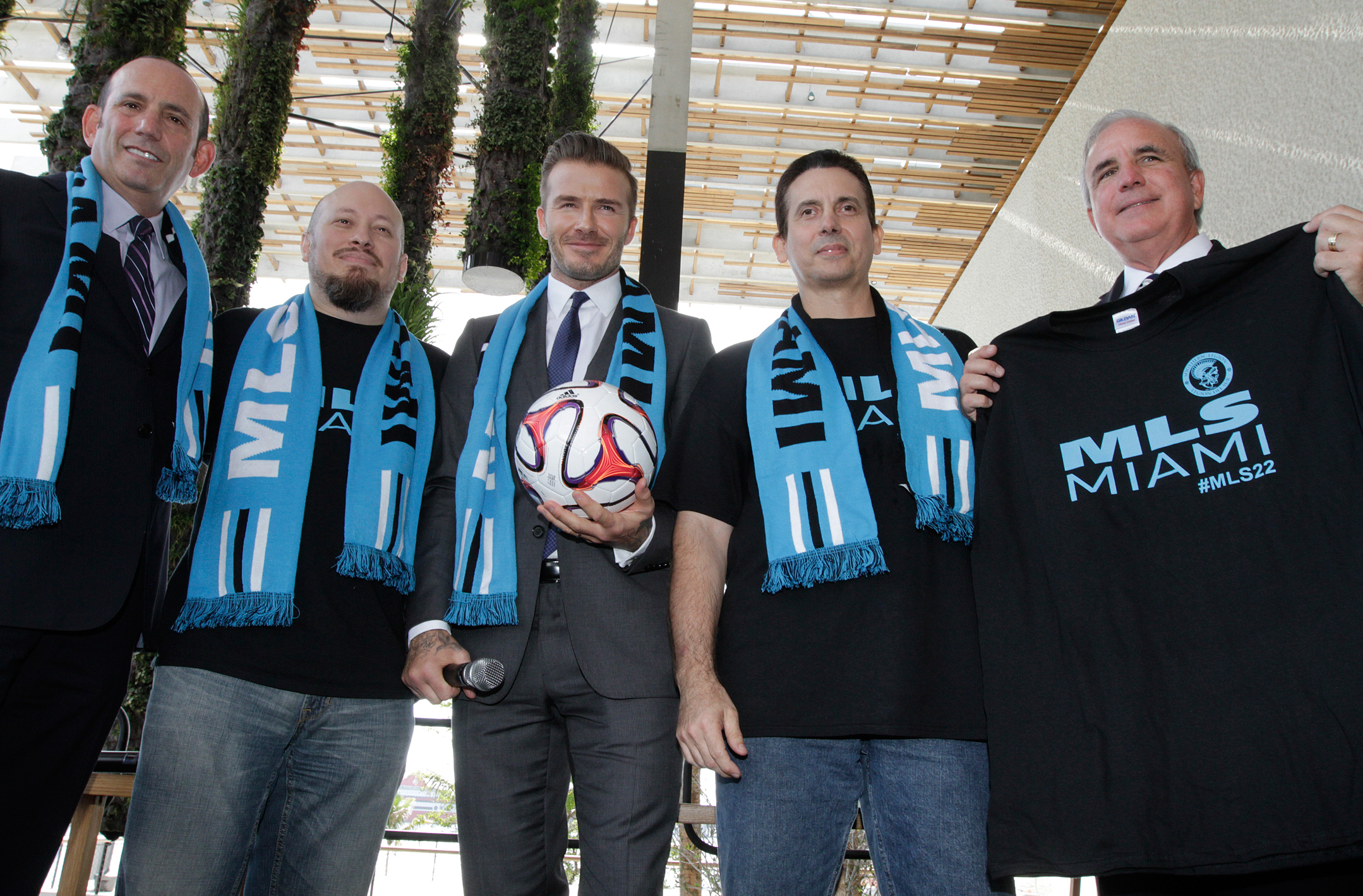 David Beckham poses for photos after holding a press conference at the Perez Art Museum Miami, in Miami, Florida on February 5, 2014 to announced his plan to buy a US team to play Major League Soccer and bring it to Miami.