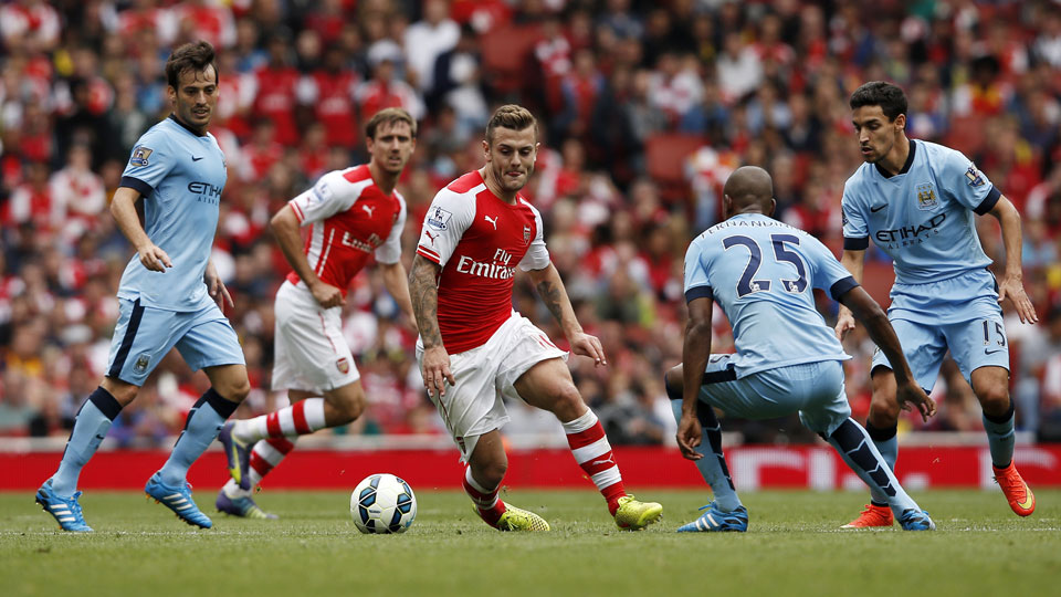 Jack Wilshere scored Arsenal's first goal in a 2-2 draw with Manchester City at the Emirates Stadium.