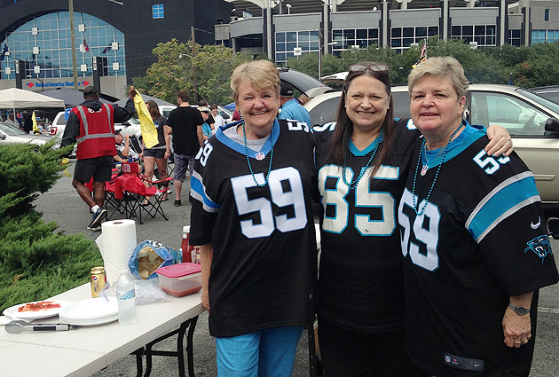 A lifelong Panthers fan, Margaret Gobble (center) felt mixed emotions about Greg Hardy's deactivation.