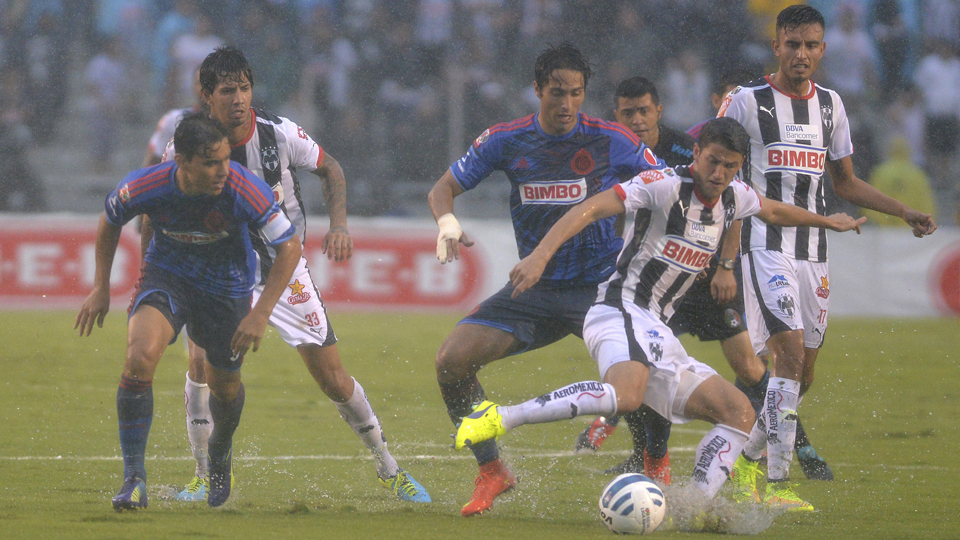 Monterrey's Hiram Mier tries to clear a ball against Chivas Guadalajara in a match that was started despite horrid conditions. It was suspended, but not until after Mier suffered a knee injury.
