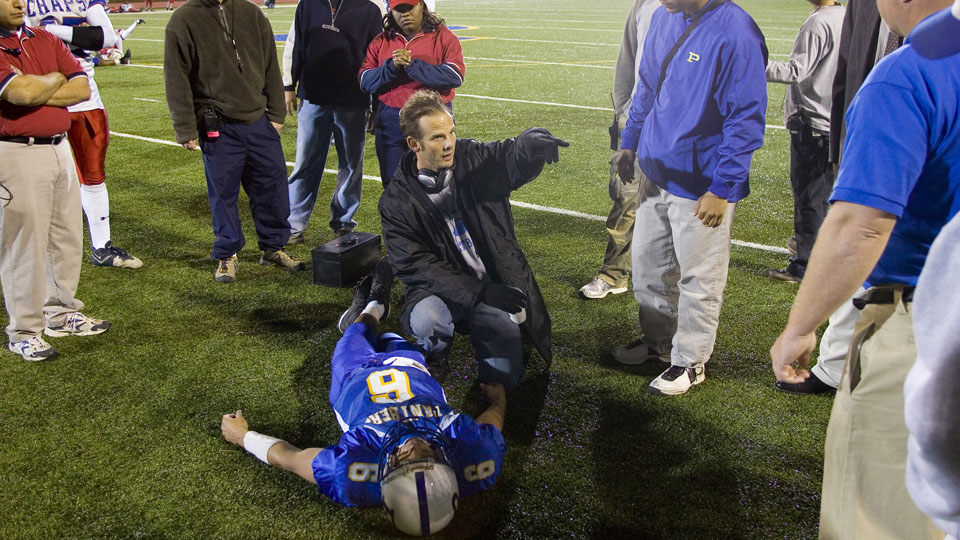 Friday Night Lights director Peter Berg (center, pointing) writes that he won't allow his son to play football.