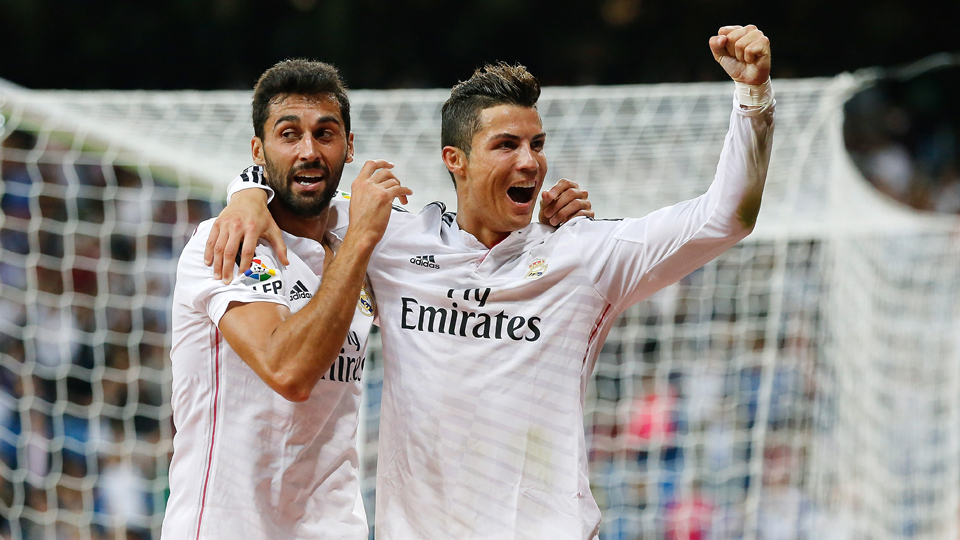Cristiano Ronaldo, right, celebrates one of his four goals against Elche on Tuesday.