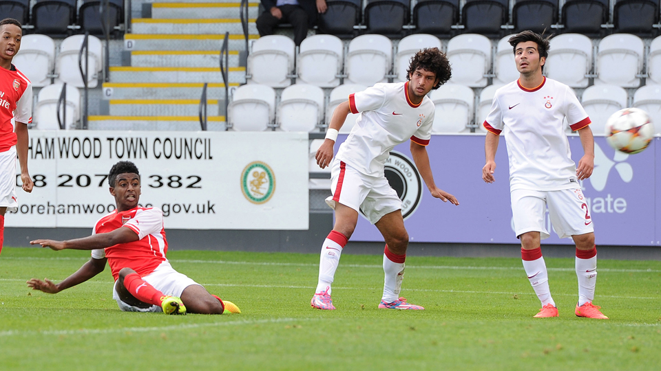 Gedion Zelalem, second from left, goes to ground while scoring a goal in Arsenal's 5-1 win over Galatasaray in the UEFA Youth League on Wednesday.