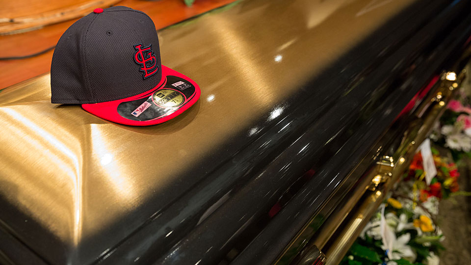 A Cardinals hat was placed on the casket of Michael Brown in August.