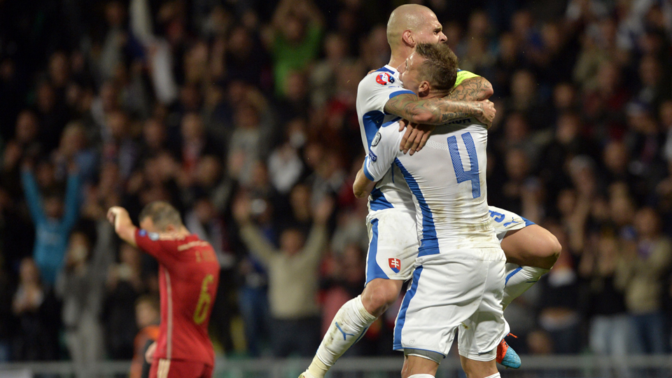 A dejected Andres Iniesta, left, walks away as Jan Durica and Martin Skrtel celebrate Slovakia's 2-1 win over Spain in Euro 2016 qualifying.