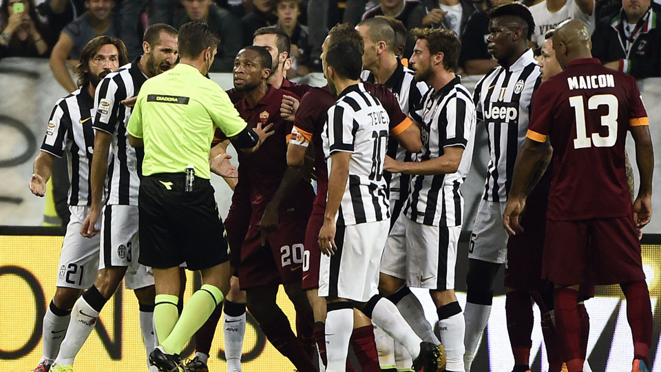 Refere Gianluca Rocchi argues with players during the Juventus vs Roma match on Oct. 5
