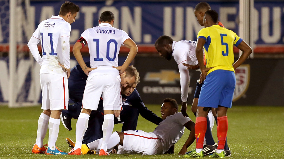 Joe Gyau is tended to by trainers and teammates after suffering a knee injury early in the USA's 1-1 draw with Ecuador last Friday.