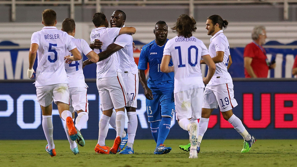 Jozy Altidore, center, gets a congratulatory hug from Alejandro Bedoya after scoring against Honduras in the 10th minute of the USA's 1-1 draw Tuesday night.