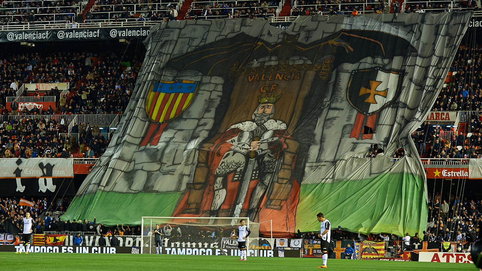 "Valencia fans drape a banner featuring a king for a Copa del Rey (""The King's Cup) match against Atletico Madrid."