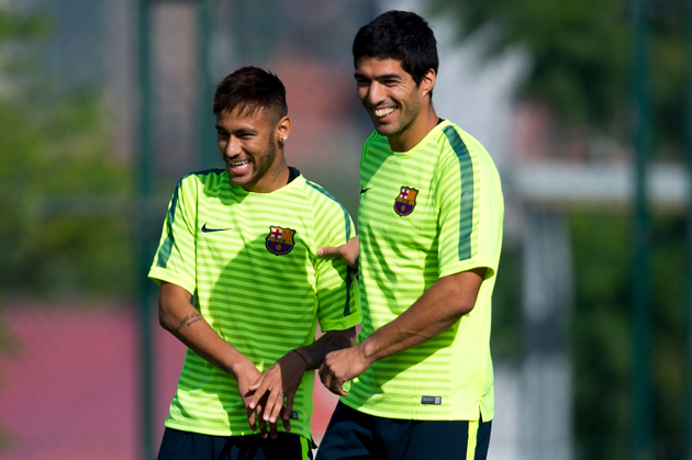 Luis Suarez, right, is set for his Barcelona debut, where he'll team with Neymar, left, and Messi to form a star-studded attacking trident.