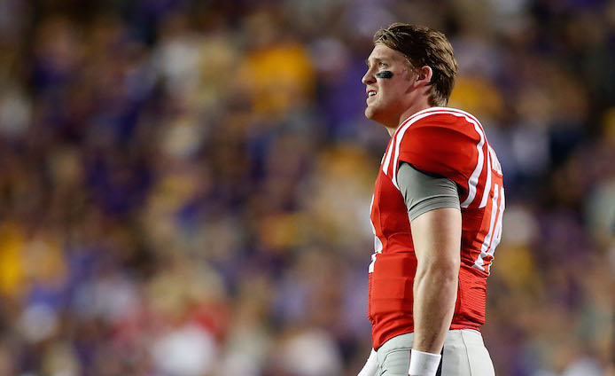 Bo Wallace lofted a controversial late-game TD pass attempt that would have won the game and covered for Ole Miss bettors - but the throw was picked off