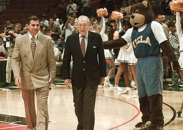 Wooden with then-UCLA coach Jim Harrick in 1995.
