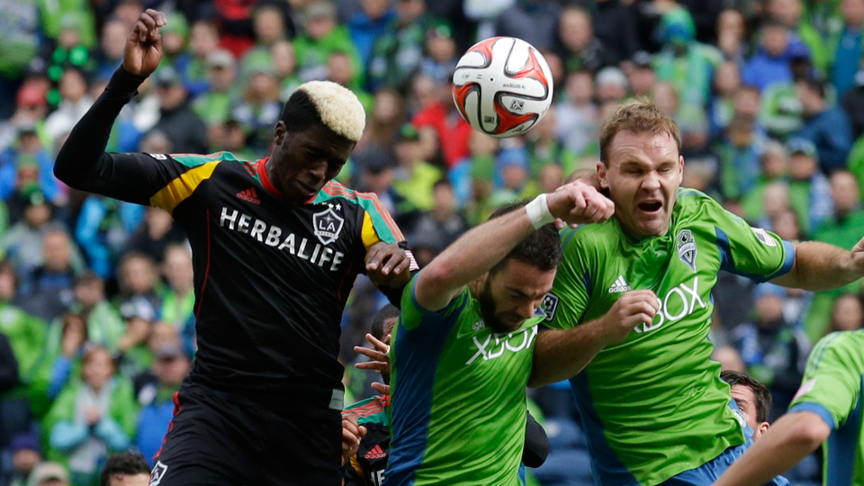 From right, Seattle defenders Chad Marshall and Zach Scott have a tall task in limiting the LA Galaxy's high-powered attack.
