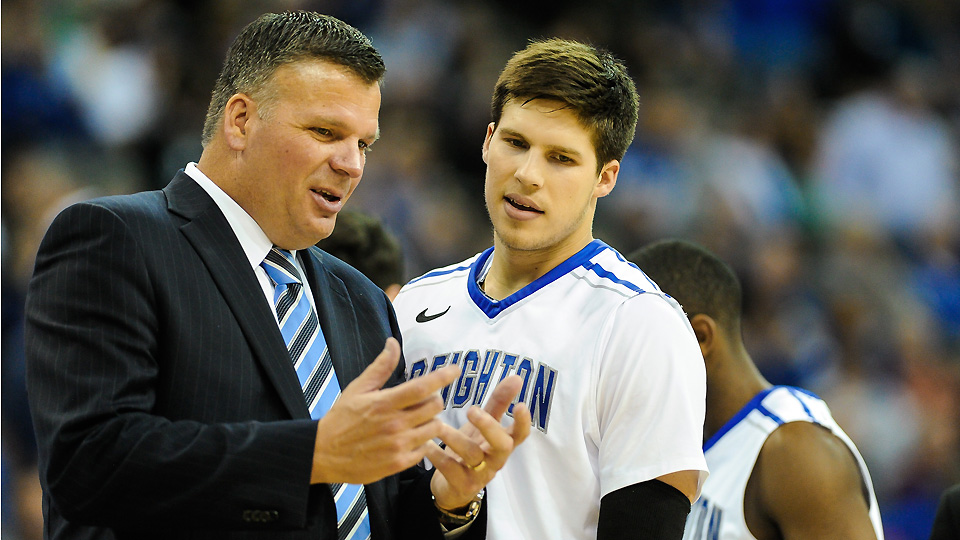 Greg McDermott (L) coached Doug through 3,150 points and 14 national player of the year awards.
