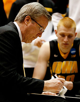 Though his mind was often back in Iowa, Fran McCaffery still coached the Hawkeyes during their NCAA tournament loss to Tennessee.