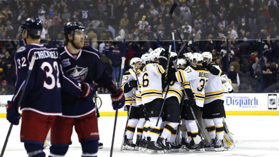 Boston Bruins' Simon Gagne, right, carries the puck as Columbus Blue Jackets' Brian Gibbons defends during the first period of an NHL hockey game Friday, Nov. 21, 2014, in Columbus, Ohio. (AP Photo/Jay LaPrete)