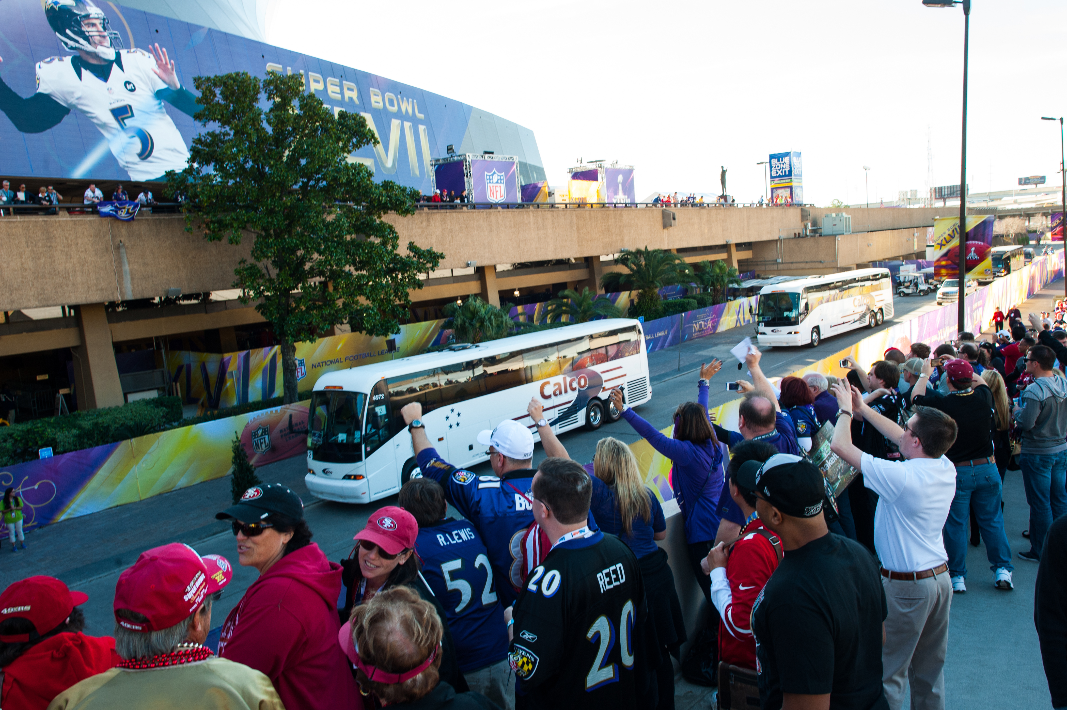 Fans cheer the buses with the players as they pull up to the stadium before Super Bowl XLVII between the Baltimore Ravens and the San Francisco 49ers in New Orleans.
