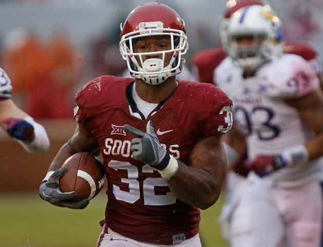 Oklahoma RB Samje Perine sets single-game rushing record against Kansas.