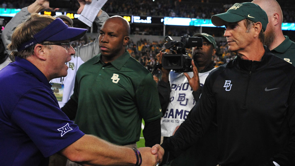 TCU coach Gary Patterson (L) and Baylor Bears coach Art Briles shake hands after the game on Oct. 11, 2014
