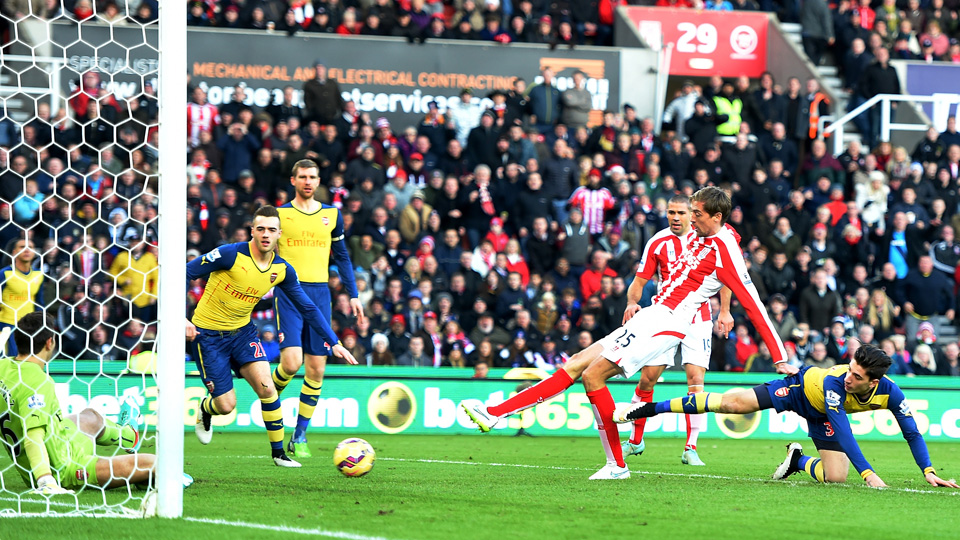 Arsenal defenders can only watch as Peter Crouch scores a 1st-minute goal in Stoke City's 3-2 win over the Gunners last weekend.