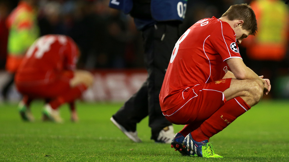 Liverpool captain Steven Gerrard crouches in disappointment after the Reds were eliminated from the Champions League with a 1-1 draw to FC Basel.