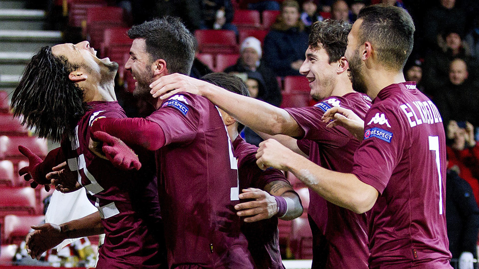 Torino players celebrate their advancement to the Europa League knockout stage.