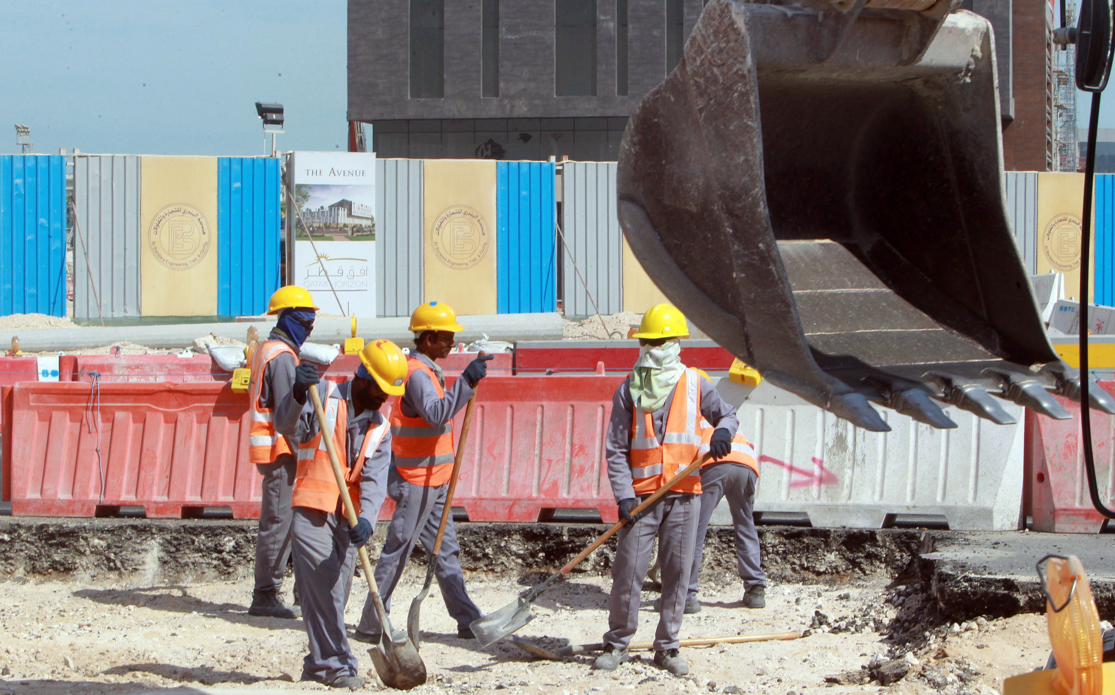 Workers are seen at a construction site in Doha, Qatar.