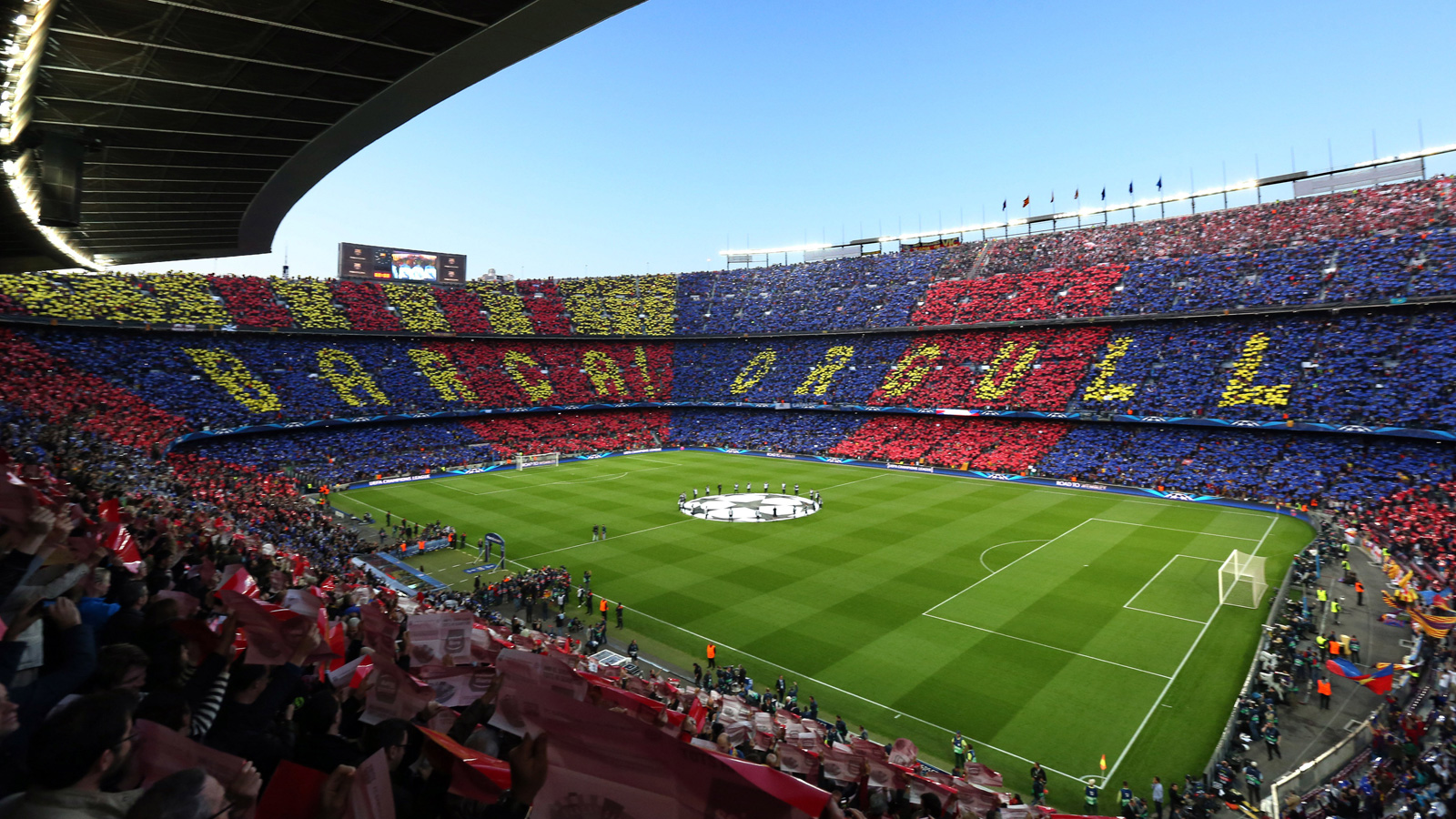 "Thousands of Barcelona fans hold up cards to spell out ""Barca! Orgull,"" which translates to ""Barcelona pride"" ahead of a Champions League clash with Bayern Munich at Camp Nou."