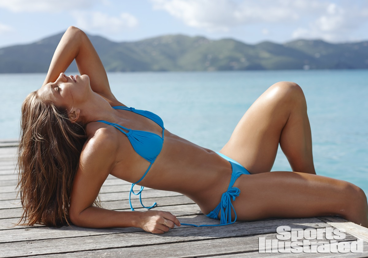 Alex Morgan was photographed by Adam Franzino in Guana Island. Swimsuit by MIKOH.