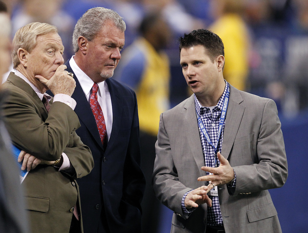 Bill Polian, Jim Irsay and Chris Polian talk before an Indianapolis Colts game on Nov. 27, 2011.