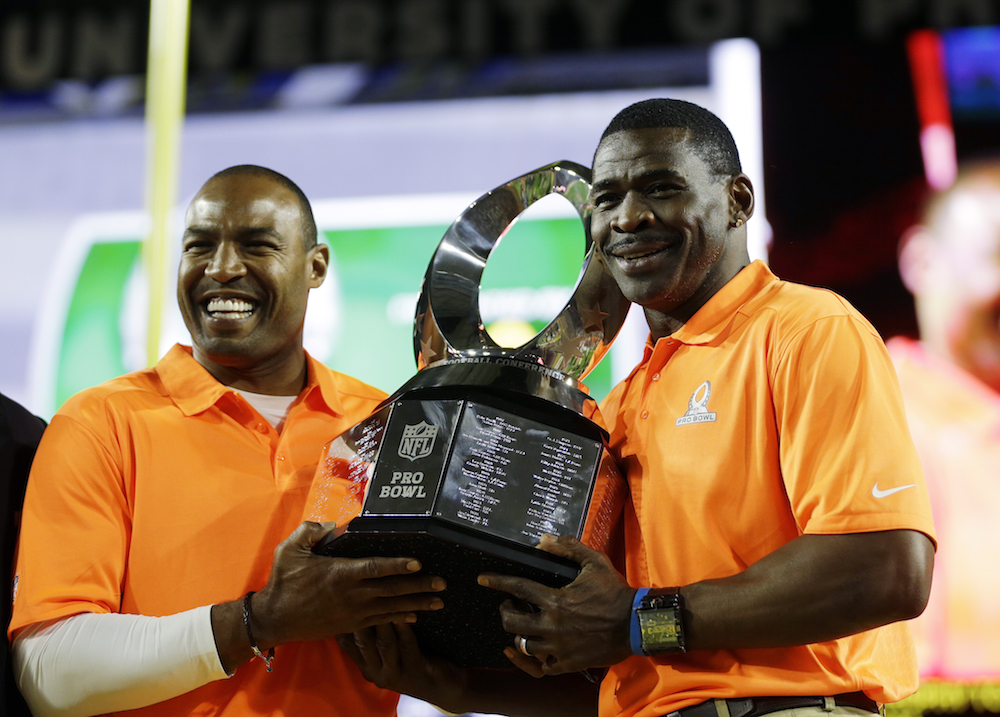 Michael Irvin and Darren Woodson hold the Pro Bowl trophy after Team Irvin defeated Team Carter 32-28.