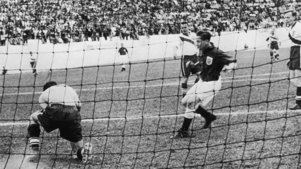 Late U.S. goalkeeper Frank Borghi, left, makes a save vs. England in the USA's historic upset in the 1950 World Cup.